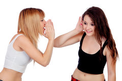 Two teen sisters whispering Royalty Free Stock Images