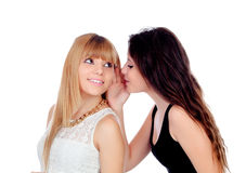 Two teen sisters whispering Royalty Free Stock Image