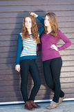Two Teen Girl Friends dressed for spring or autumn outdoors Stock Photos