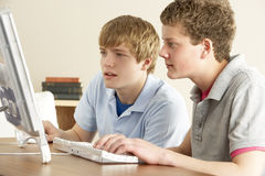 Two Teenage Boys on Computer at Home Stock Images