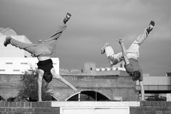 Two teenage boys practice free running royalty free stock photos