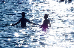 Two teenage boys in the sea Royalty Free Stock Images