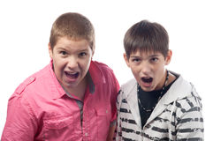 Two teenage boys shouting and screaming Royalty Free Stock Photo