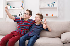 Two teenage boys taking selfie at home, friendship Royalty Free Stock Photos