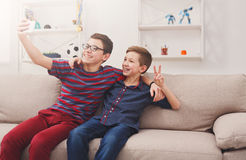 Two teenage boys taking selfie at home, friendship Stock Photos