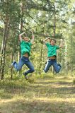 Two teenage brothers jumping Royalty Free Stock Photo