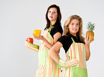 Two teenage cooks Stock Images