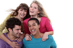 Two teenage couples in studio royalty free stock photos