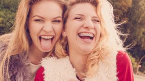 Two crazy women having fun outdoor stock photo