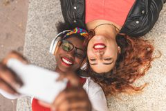 Two Teenage Female Friends Taking a Selfie Outdoors stock photos