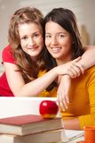 Two teenage friends hugging Stock Photo