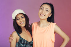 Two teenage friends in studio Royalty Free Stock Images