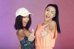 Two teenage friends in studio Stock Photography