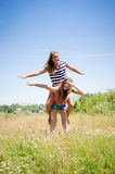 Two teenage girl friends having fun outdoors on summer day Royalty Free Stock Photography