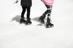 Two teenage girl friends skating on ice stock photo