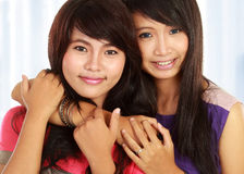 Two teenage girls. Close up portrait of attractive two teenage girls hugging each other Royalty Free Stock Images