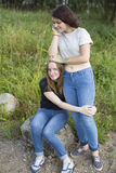 Two teenage girls are best friends hugging at the glade. Nature. Royalty Free Stock Images