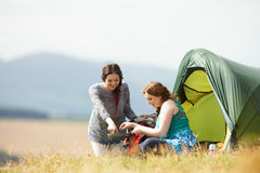 Two Teenage Girls On Camping Trip In Countryside Stock Photos