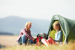 Two Teenage Girls On Camping Trip In Countryside Stock Image