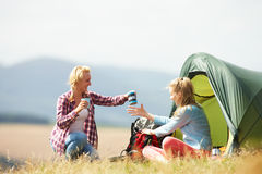 Two Teenage Girls On Camping Trip In Countryside Stock Photo