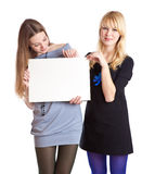 Two teenage girls with card for text Royalty Free Stock Photo