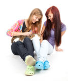 Two teenage girls  with cat Stock Photos