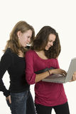 Two teenage girls checking mail Royalty Free Stock Images