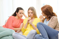 Two teenage girls comforting another after breakup royalty free stock image