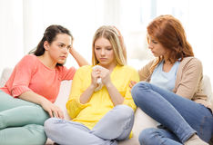 Two teenage girls comforting another after breakup royalty free stock photo