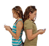 Teenage Girls Text Messaging Instead Of Talking Stock Photography