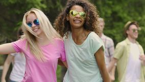 Two teenage girls dancing, having crazy fun with friends outdoors, summertime. Stock footage stock footage