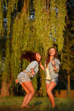 Two teenage girls dancing Stock Photo