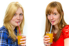 Two teenage girls drinking soft drinks Stock Image