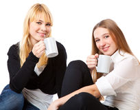 Two teenage girls is drinking tea Stock Photos