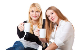 Two teenage girls is drinking tea Stock Images