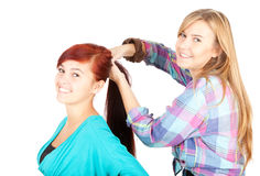 Two teenage girls, friends. On the white background Stock Images
