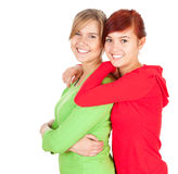 Two teenage girls, friends. Standing on the white background Royalty Free Stock Image