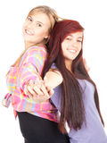 Two teenage girls friends. Two teenage girls, friends standing on the white background Stock Photo