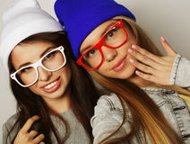 Two teenage girls friends in hipster outfit make selfie Royalty Free Stock Photo