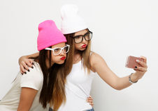 Two teenage girls friends in hipster outfit make selfie Stock Photo