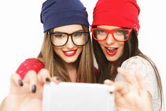 Two teenage girls friends in hipster outfit make selfie Stock Images