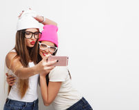 Two teenage girls friends in hipster outfit make selfie Stock Photography