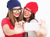 Two teenage girls friends in hipster outfit make selfie Stock Photos