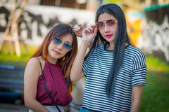 Two teenage girls friends in hipster outfit.at the park outdoors Stock Photo