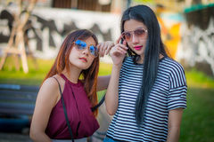 Two teenage girls friends in hipster outfit.at the park outdoors Royalty Free Stock Photography