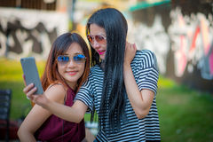 Two teenage girls friends in hipster outfit.at the park outdoors Royalty Free Stock Photos