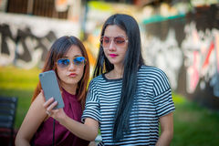 Two teenage girls friends in hipster outfit.at the park outdoors Stock Photography