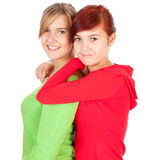 Two teenage girls, friends hugging. On the white background Stock Photo
