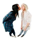 Two teenage girls greeting Stock Image
