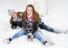 Two teenage girls having fun in the snow Royalty Free Stock Image